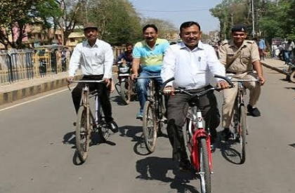 Environment  health  bicycle  save fuel  office  ride  Ashoknagar  Madhya Pradesh  example
