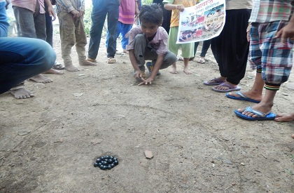 A game from the past: Kanchaa contest has underprivileged kids in throes of joy